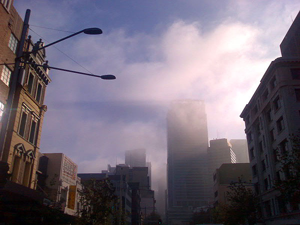 Photograph of George Street, Sydney, showing buildings in the distance partially obscured by fog