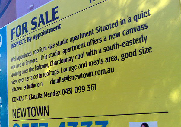 Photo of real estate sign reading: Well appointed medium size studio apartment Situated in a quiet enclave in Enmore. This studio apartment offers a new canvass awning over the balcony, Chardonnay cool with a south-easterly view over terra cotta rooftops. Lounge and meals area, good size kitchen & bathroom