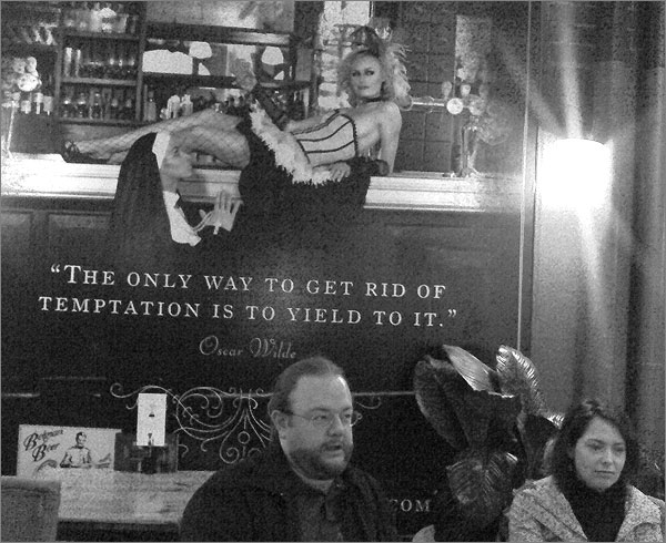 Photograph of poster quoting Oscar Wilde: The only way to get rid of temptation is to yield to it