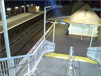 Photo of stairs descending to the deserted platform at Gordon Station