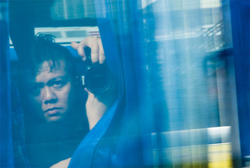 Photo: self-portrait of 'Pong through a bus window