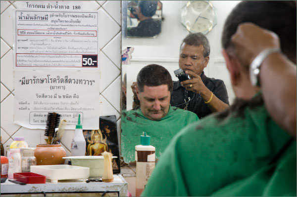 Photograph of Stilgherrian having a haircut in Bangkok