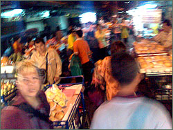 Photograph of a crowded market street in Chinatown, Bangkok