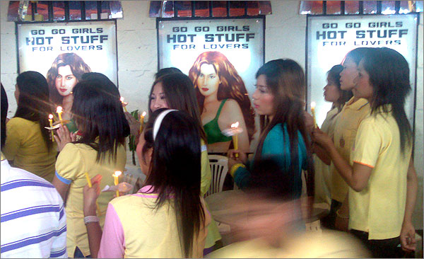 Photograph of bar girls in Patpong Road, Bangkok, celebrating the birthday of the Thai king