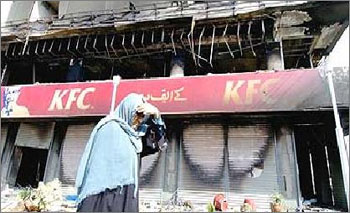 Photograph of burned-out KFC store