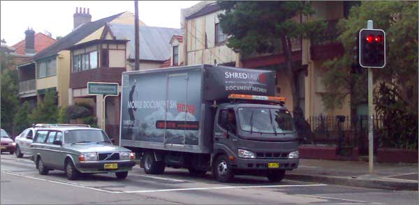 Photograph of truck for mobile shredding service, with amber flashing lights!