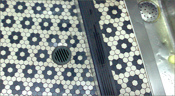Photograph of hexagonal tiles on the toilet floor, Lansdowne Hotel, Sydney
