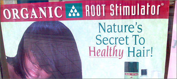 Photograph of sign advertising Organic Root Stimulator