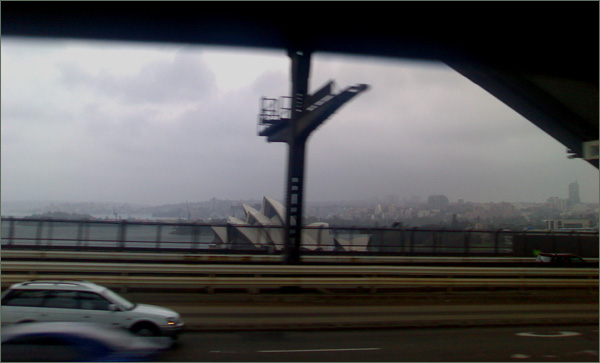 Photograph of storm clouds over the Sydney Opera House, taken from the Sydney Harbour Bridge