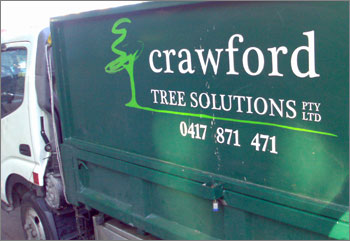 Photograph of truck with sign on side: Crawford Tree Solutions Pty Ltd 0417 871 471