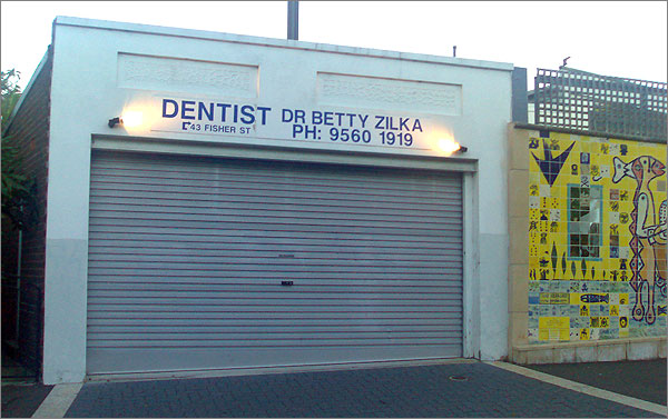Photo of dentist premises with garage-style roll-up door