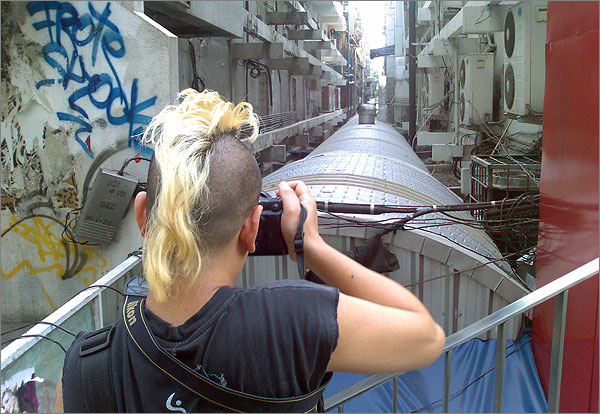 Photograph of Trinn Suwannapha taking a photo in Bangkok