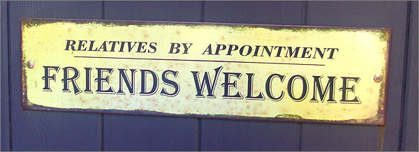 Photograph of sign on gate: Relatives by appointment, friends welcome