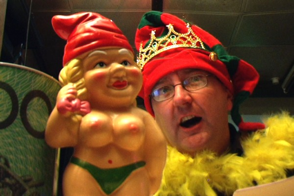 Photo of female garden gnome with bare breasts and a green g-string