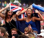 Elissa Cameron and Clare Werbeloff wave the Australian flag during the Big Day Out in Homebush Pic. Chris Hyde