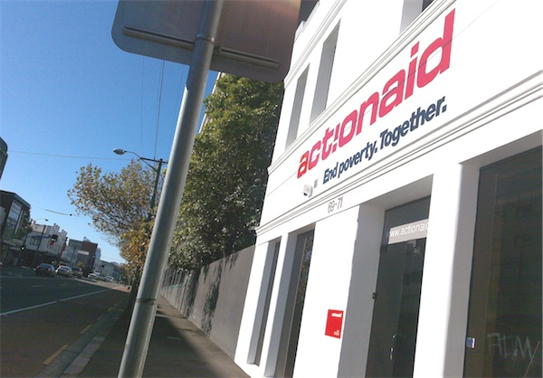 Photo of ActionAid Australia office, showing slogan: End poverty. Together.