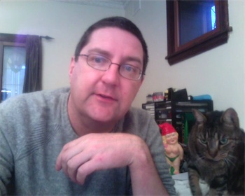 Screenshot from Project TOTO video diary, with Gnaomi the topless gnome and Apollo the cat