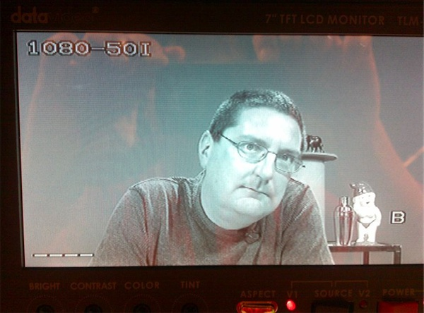 Photo of monitor at Metro Screen showing Stilgherrian on camera, waiting for his cue