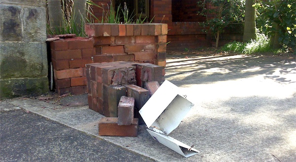 Photograph of our broken brick fence and letterbox