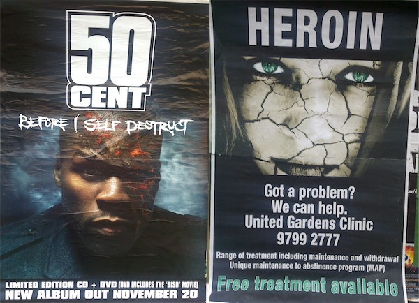 Photograph of posters advertising 50 Cent's new album and a heroin treatment clinic with remarkably similar imagery