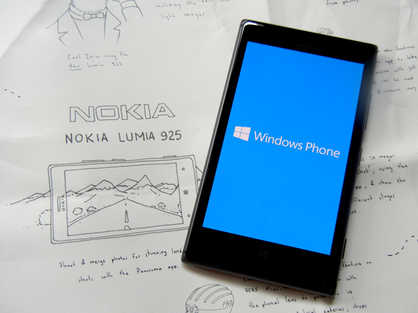 Nokia Lumia 925 smartphone pictured against the Reviewers Guide: click to embiggen