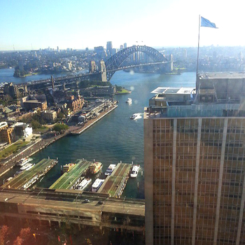 Sydney Harbour, viewed through a dirty window in the AMP Tower: click to embiggen