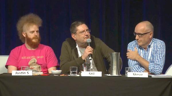 Stilgherrian speaking at the AusCERT 2016 Speed Debate, flanked by Justin Steven and Steve Wilson