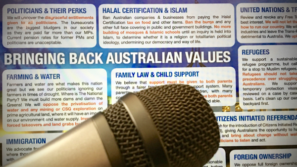 Photo of One Nation's policy flyer, with a microphone in the foreground