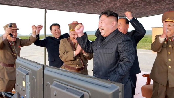 Kim Jong-Un celebrating after the successful launch of the missile.  Reuters/KCNA